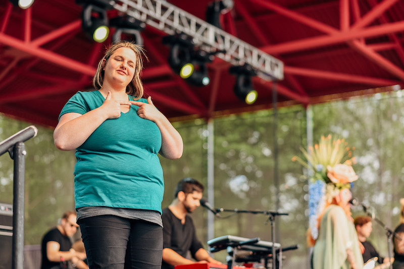 interpreter on festival stage