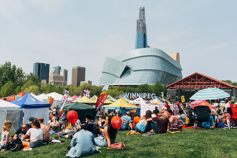 the pride festival at the forks and the human rights museum on the background