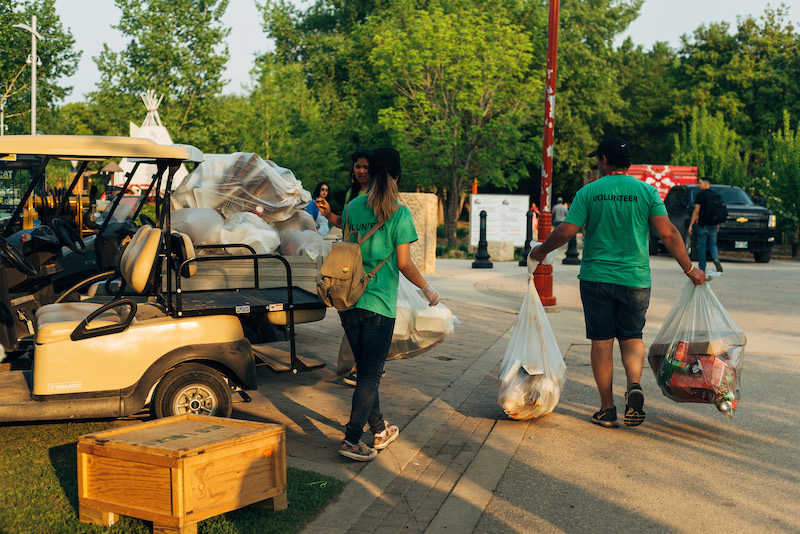 two volunteers working on recycling