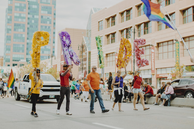 people holding pride letter signage