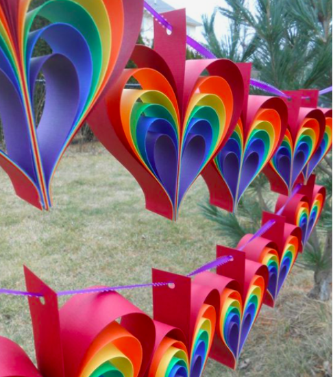 rainbow hearts made out of coloured paper